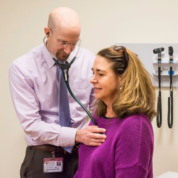 A patient consults with her doctor at Stanford Health Care.